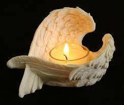 Candle surrounded by white wings